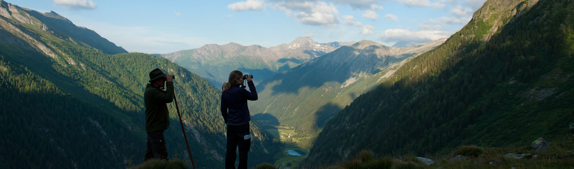 Hikers with binoculars in the mountains