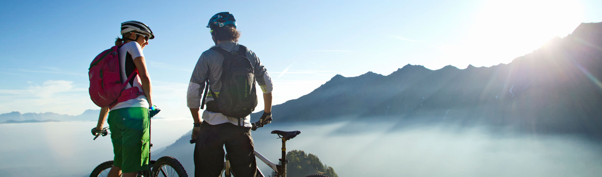Couple with mountainbikes on a mountain