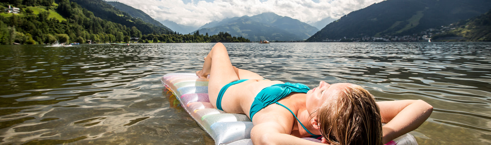 Woman on an air mattress on a lake